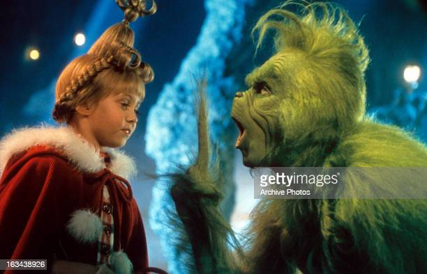 Taylor Momsen listening to Jim Carrey in a scene from the film 'How The Grinch Stole Christmas' 2000