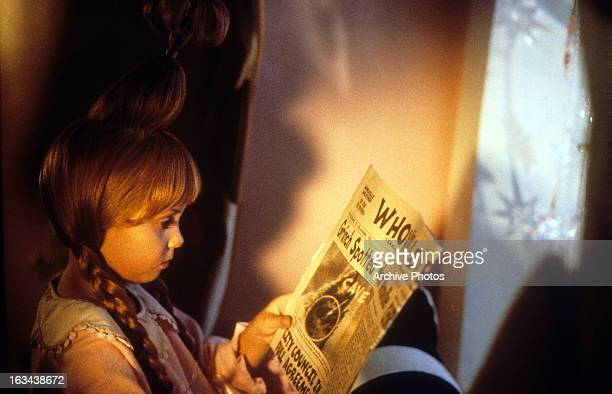 taylor momsen reading newspaper about the grinch in a scene from the film how the - How The Grinch Stole Christmas 2000 Cast