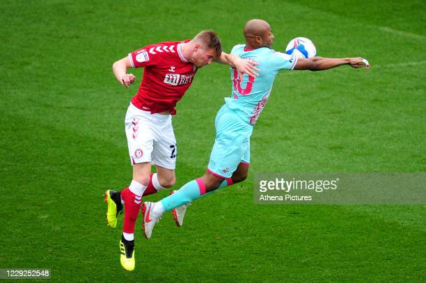 Taylor Moore of Bristol City battles with André Ayew of Swansea City during the Sky Bet Championship match between Bristol City and Swansea City at...