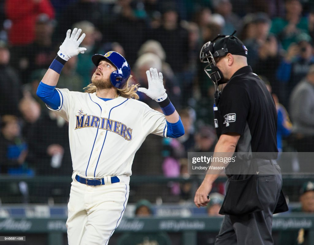 Taylor Motter #21 of the Seattle Mariners celebrates his home run in the fifth inning against the Oakland Athletics at Safeco Field on April 15, 2018 in Seattle, Washington. All players are wearing #42 in honor of Jackie Robinson Day.