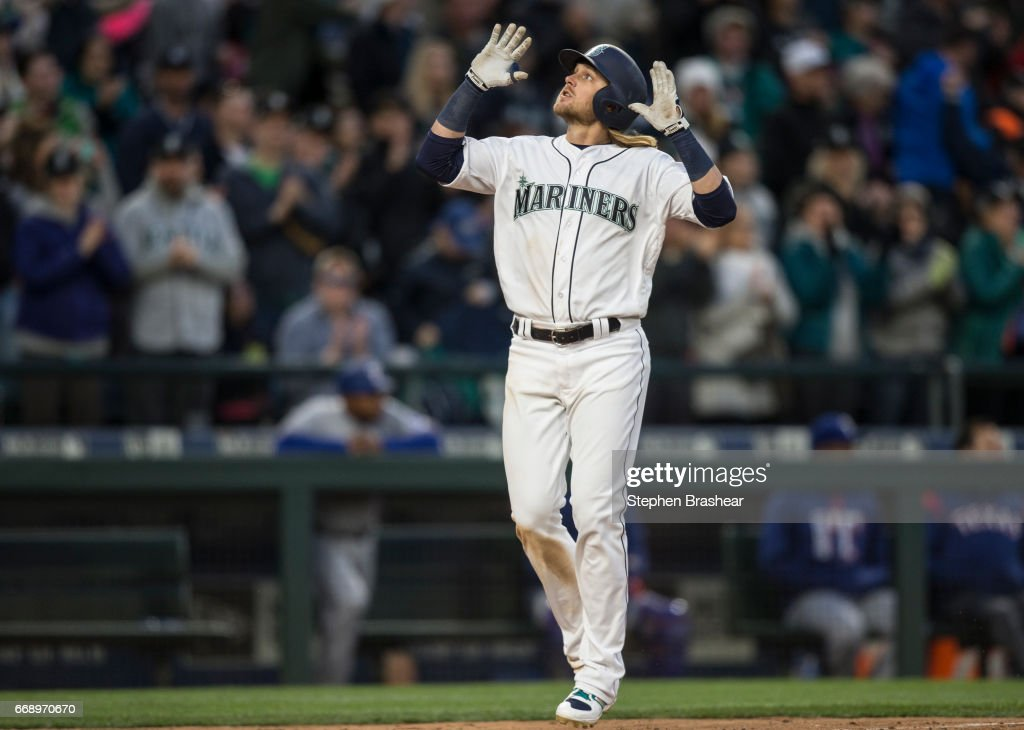 Taylor Motter #21 of the Seattle Mariners celebrates hitting a three-run home run off of relief pitcher Mike Hauschild #49 of the Texas Rangers scoring Kyle Seager #15 of the Seattle Mariners and Nelson Cruz #23 of the Seattle Mariners during the sixth inning of a game at Safeco Field on April 15, 2017 in Seattle, Washington. All players are wearing #42 in honor of Jackie Robinson Day.