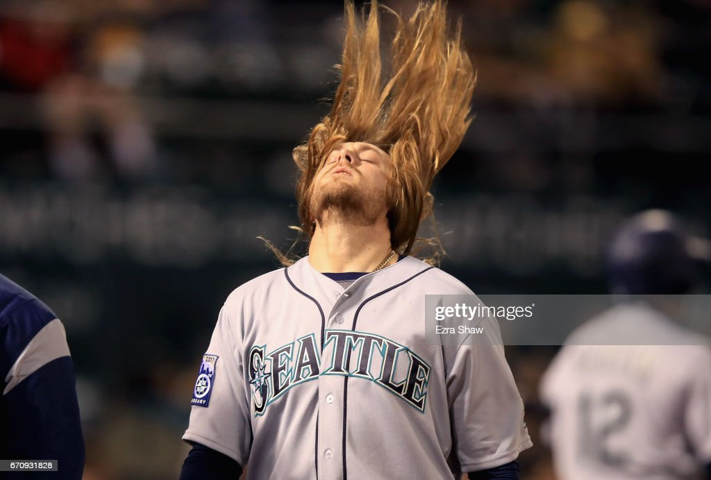 Taylor Motter #21 of the Seattle Mariners flips his hair after hitting a two-run home run in the sixth inning against the Oakland Athletics at Oakland Alameda Coliseum on April 20, 2017 in Oakland, California.