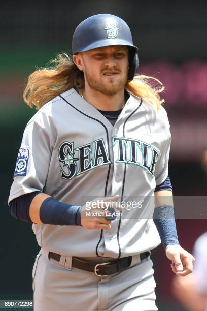 Taylor Motter of the Seattle Mariners runs back to the dug out during a baseball game against the Washington Nationals at Nationals Park on May 25...