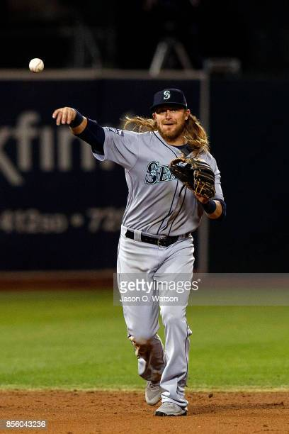 Taylor Motter of the Seattle Mariners throws to first base against the Oakland Athletics during the sixth inning at the Oakland Coliseum on September...