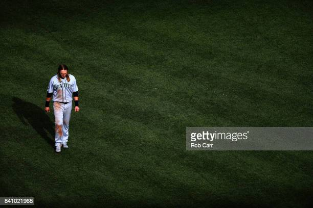 Taylor Motter of the Seattle Mariners walks back to the dugout after hitting into a double play to end the sixth inning against the Baltimore Orioles...