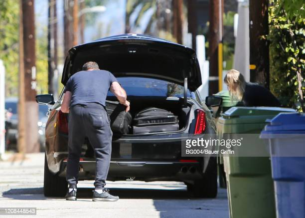 Taylor Neisen and Liev Schreiber are seen on March 27 2020 in Los Angeles California