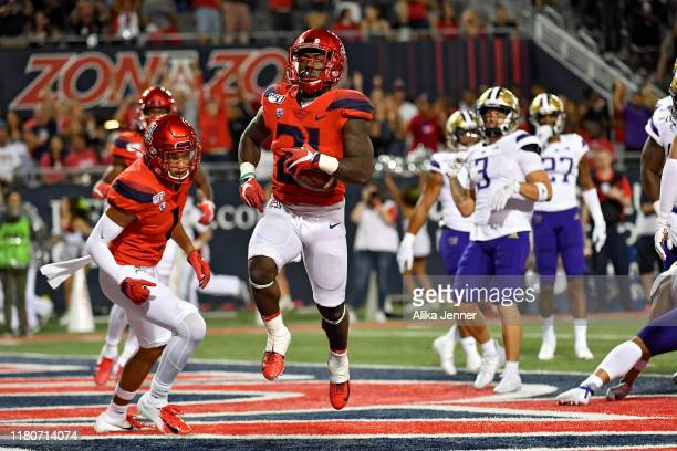 J Taylor of the Arizona Wildcats runs for a 1 yard touchdown at end of the second quarter of the game against the Washington Huskies at Arizona...
