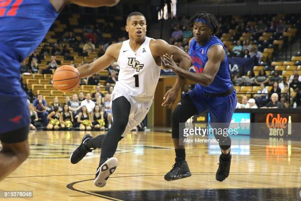 J Taylor of the UCF Knights drives past Elijah Landrum of the Southern Methodist Mustangs during a NCAA basketball game at the CFE Arena on February...