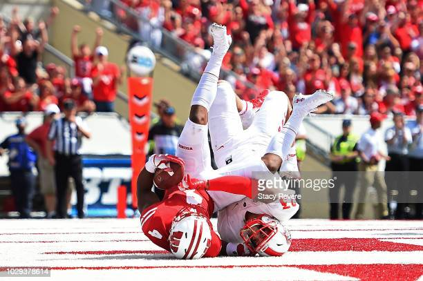 J Taylor of the Wisconsin Badgers catches a pass for a touchdown in front of Marcus Hayes of the New Mexico Lobos during the second half of a game at...