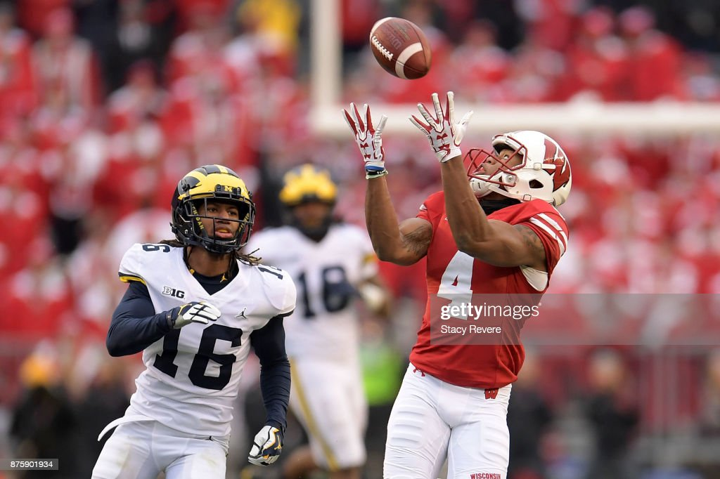 A.J. Taylor #4 of the Wisconsin Badgers catches a pass in front of Jaylen Kelly-Powell #16 of the Michigan Wolverines during the third quarter of a game at Camp Randall Stadium on November 18, 2017 in Madison, Wisconsin.