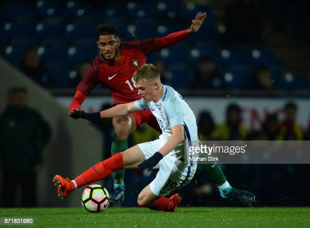 Taylor Perry of England U17s and Pinto Vieira Fernandes Rodrigo Francisco of Portugal 17s in action during the International Match between England...