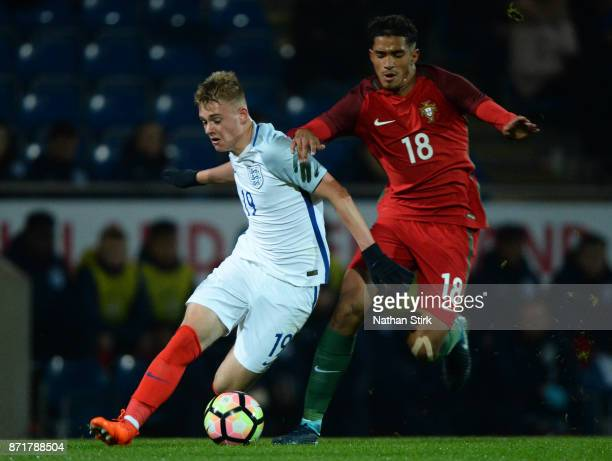 Taylor Perry of England U17s and Rodrigo Francisco Pinto Vieira Fernandes of Portugal 17s in action during the International Match between England...