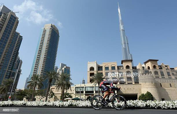 Taylor Phinney of the USA and BMC Racinf team races past the Burj Khalifa during the time trial on stage one of the 2014 Tour of Dubai on February 5...