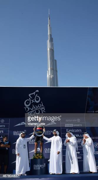 Taylor Phinney of the USA and BMC Racing Team is awarded the trophy by Sheikh Majed Bin Rashid alMaktoum son of Sheikh Mohammed Bin Rashid alMaktoum...