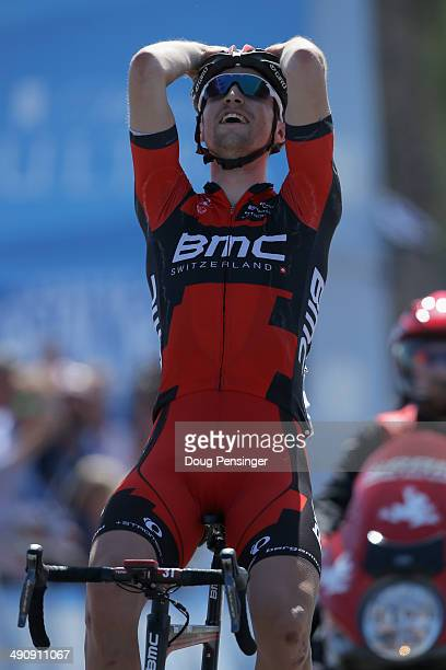 Taylor Phinney of the USA riding for the BMC Racing Team celebrates as he crosses the finish line to claim victory in stage five of the 2014 Amgen...