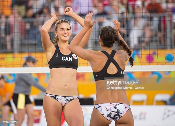 Taylor Pischke and Melissa Humana-Paredes of Canada celebrate during their victory over Uruguay during the the preliminary rounds of beach volleyball...