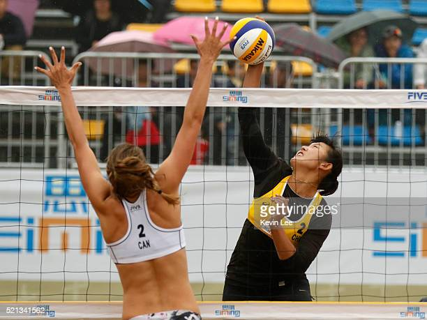 Taylor Pischke of Canada and Yuan Yue of China in action at the FIVB Beach Volleyball World Tour Xiamen 2016 on April 15, 2016 in Xiamen, China.