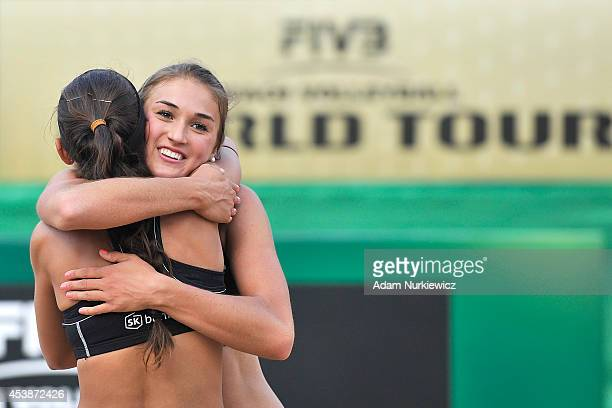 Taylor Pischke of Canada celebrates a winning point with her team mate Melissa Humana - Paredes during the FIVB Beach Volleyball Grand Slam on August...