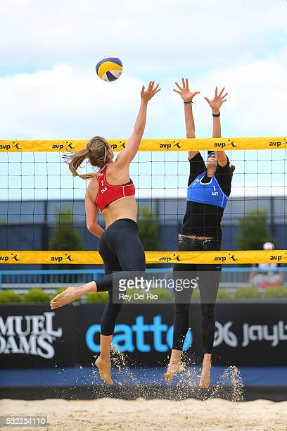 Taylor Pischke of Canada hits the ball over the net against Lena Plesiutschnig of Austria during day 2 of the 2016 AVP Cincinnati Open on May 18,...
