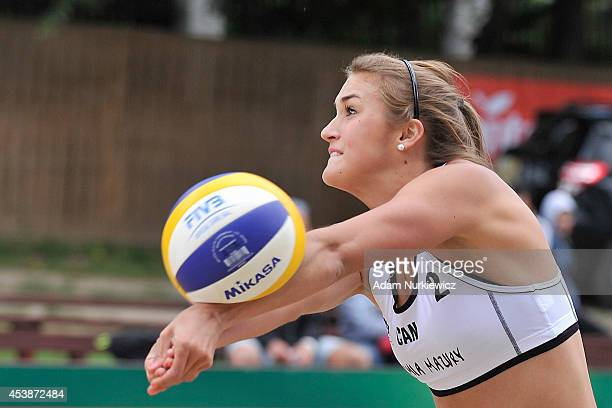 Taylor Pischke of Canada receives the ball during the FIVB Beach Volleyball Grand Slam on August 20, 2014 in Stare Jablonki, Poland.