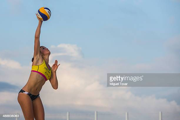 Taylor Pischke of Canada serves during a qualification match against Marloes Wesselink and Laura Bloem of Netherlans as part of the 2014 FIVB Beach...