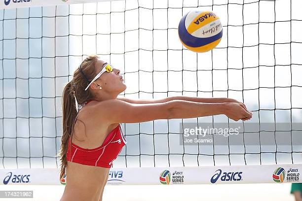 Taylor Pischke of Canada sets the ball during play at the ASICS World Series of Beach Volleyball - Day 2 on July 23, 2013 in Long Beach, California.