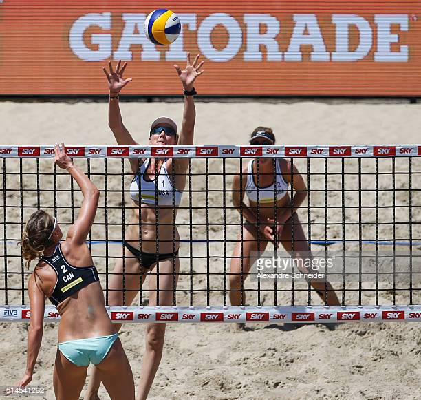 Taylor Pischke of Canada spikes the ball against Kerri Walsh of the United States during the main draw match against at Copacabana beach during day...