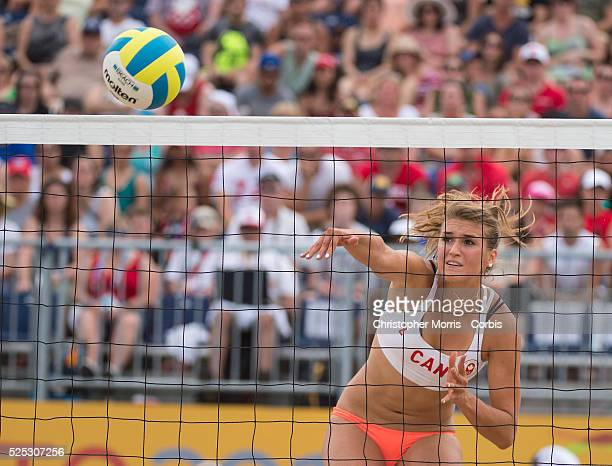 Taylor Pischke of Canada spikes the ball during Canada vs. Cuba in beach volleyball competition at the 2015 PanAm Games in Toronto.