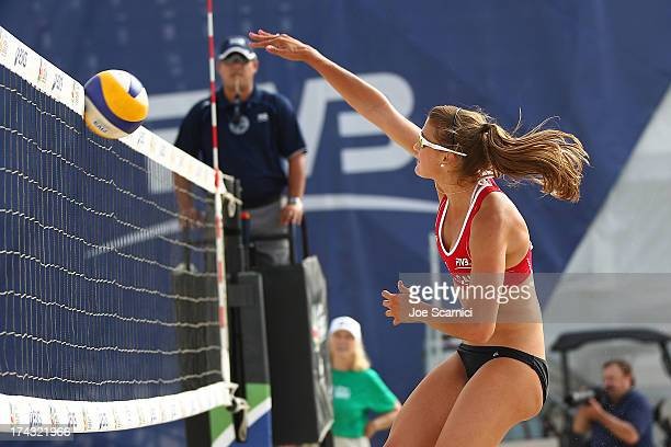 Taylor Pischke of Canada spikes the ball into the net during play at the ASICS World Series of Beach Volleyball - Day 2 on July 23, 2013 in Long...
