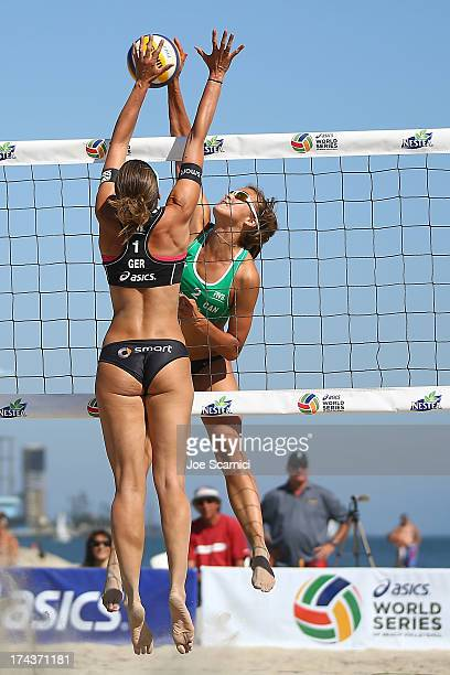 Taylor Pischke of Canada spikes the ball over Katrin Holtwick of Germany during the first elimination round at the ASICS World Series of Beach...