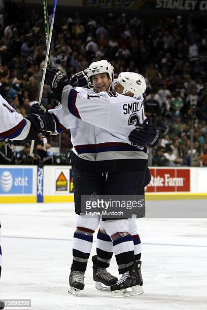 Taylor Pyatt and Bryan Smolinski of the Vancouver Canucks celebrate Pyatts game winning goal against the Dallas Stars during the first overtime of...