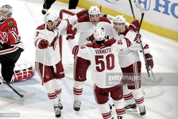 Taylor Pyatt and Radim Vrbata of the Phoenix Coyotes celebrate with teammates after Pyatt scored against the Chicago Blackhawks during Game Four of...