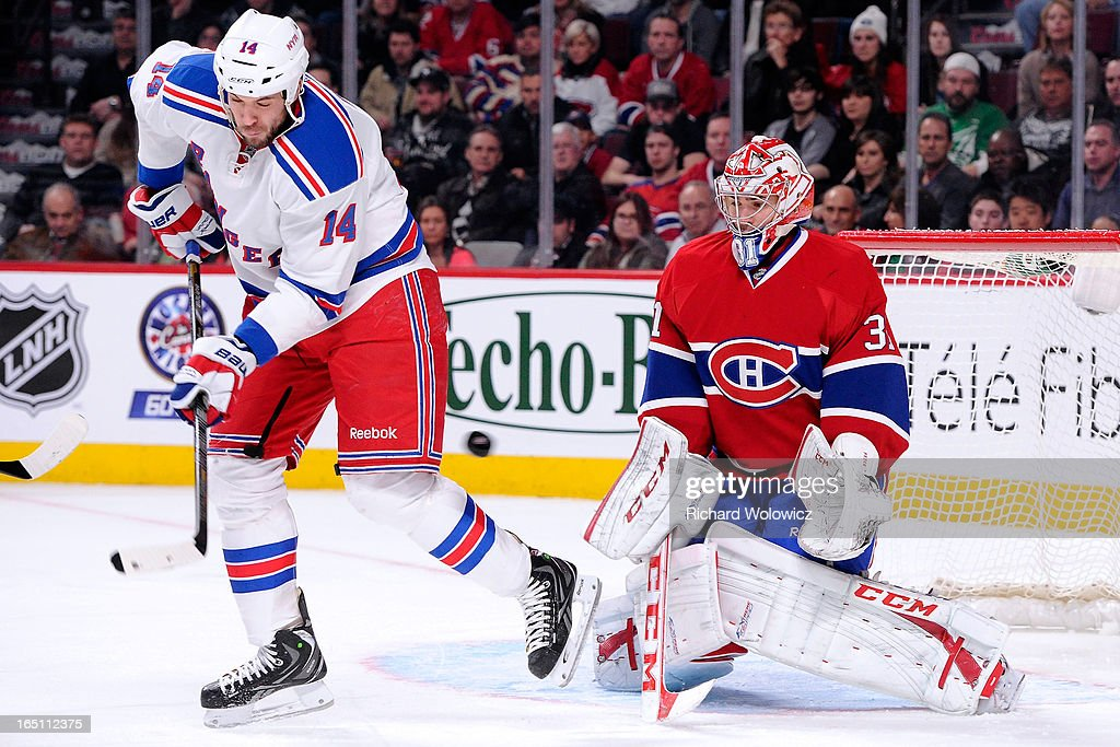 Taylor Pyatt #14 of the New York Rangers attempts to deflect the puck in front of Carey Price #31 of the Montreal Canadiens during the NHL game at the Bell Centre on March 30, 2013 in Montreal, Quebec, Canada.