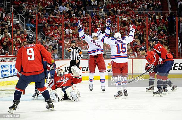 Taylor Pyatt of the New York Rangers celebrates with Derek Dorsett after scoring in the second period against the Washington Capitals in Game Seven...