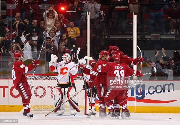 Taylor Pyatt of the Phoenix Coyotes celebrates with teammates after scoring the game winning goal past goaltender Miikka Kiprusoff of the Calgary...