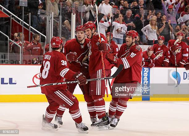 Taylor Pyatt of the Phoenix Coyotes celebrates with teammates Vernon Fiddler Zbynek Michalek and Ed Jovanovski after Pyatt scored a second period...