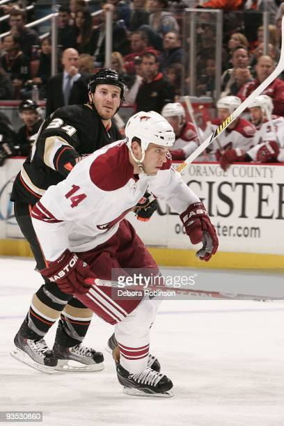 Taylor Pyatt of the Phoenix Coyotes gets a push from behind from James Wisniewski of the Anaheim Ducks during the game on November 29 2009 at Honda...