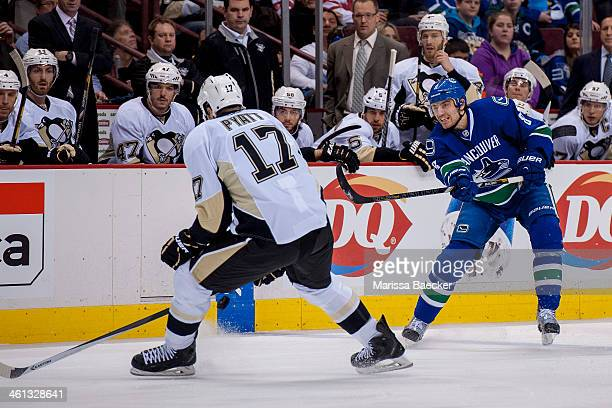 Taylor Pyatt of the Pittsburgh Penguins tries to block a shot from Chris Tanev of the Vancouver Canucks during the first period on January 7 2014 at...