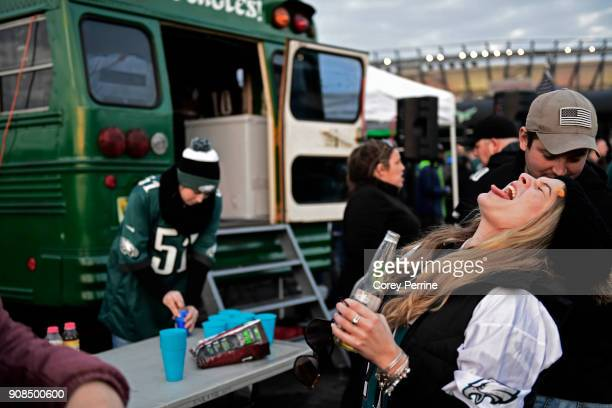 Taylor Radano of Haddon Township New Jersey can't catch a goldfish cracker in her mouth while tailgating at Lincoln Financial Field on January 21...