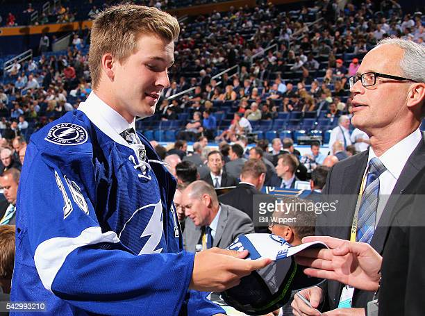 Taylor Raddysh looks to put on his hat after being selected 58th overall by the Tampa Bay Lightning during the 2016 NHL Draft at First Niagara Center...