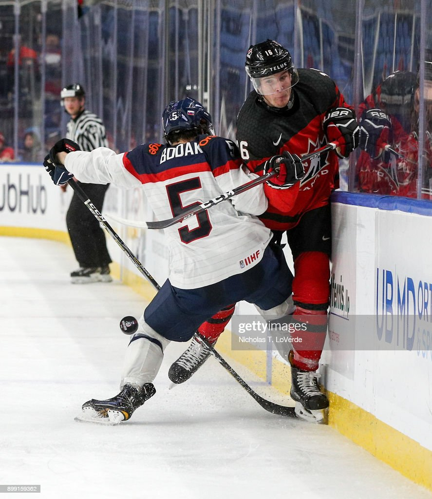 Taylor Raddysh #16 of Canada absorbs a check thrown at him by Martin Bodák #5 of Slovakia during the third period of play in the IIHF World Junior Championships at the KeyBank Center on December 27, 2017 in Buffalo, New York.