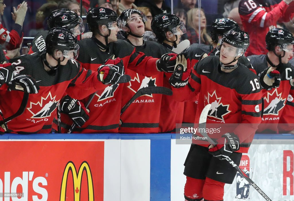 Taylor Raddysh #16 of Canada celebrates with the bench after he scored on Finland during the second period at KeyBank Center on December 26, 2017 in Buffalo, New York.