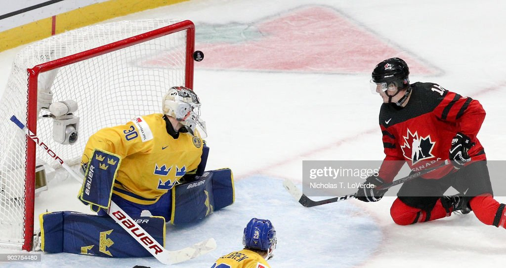 Taylor Raddysh #16 of Canada hits the goalpost behind Filip Gustavsson #30 of Sweden during the third period of play in the IIHF World Junior Championships Gold Medal game at KeyBank Center on January 5, 2018 in Buffalo, New York.