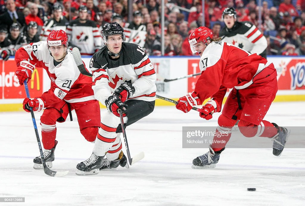 Taylor Raddysh #16 of Canada skates past Daniel Nielsen #21 and Lucas Andersen #17 of Denmark during the first period of play in the IIHF World Junior Championships at the KeyBank Center on December 30, 2017 in Buffalo, New York.