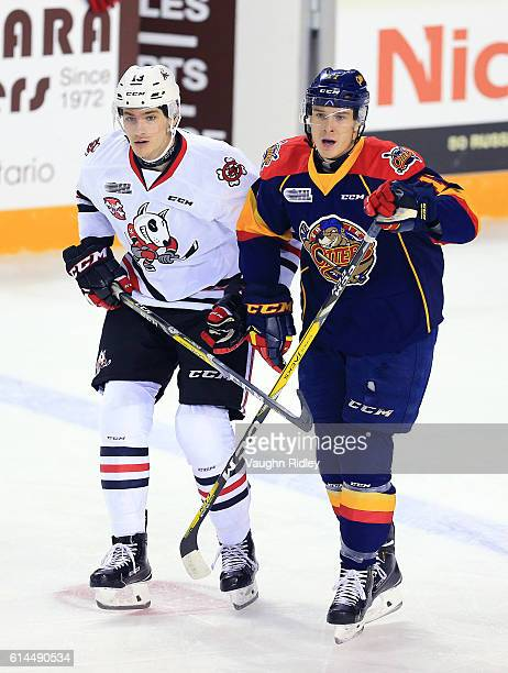 Taylor Raddysh of the Erie Otters and Graham Knott of the Niagara IceDogs battle for the puck during the first period of an OHL game at the Meridian...