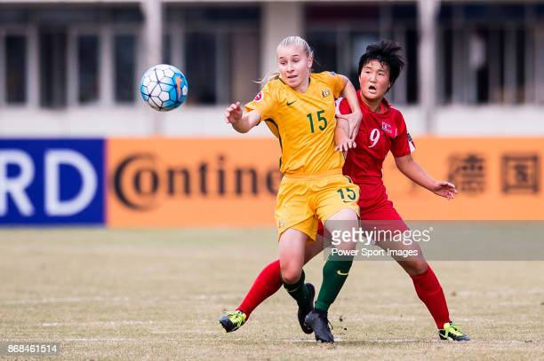 Taylor Ray of Australia fights for the ball with Kim Pom Ui of DPR Korea during their AFC U19 Women's Championship 2017 SemiFinals match between...
