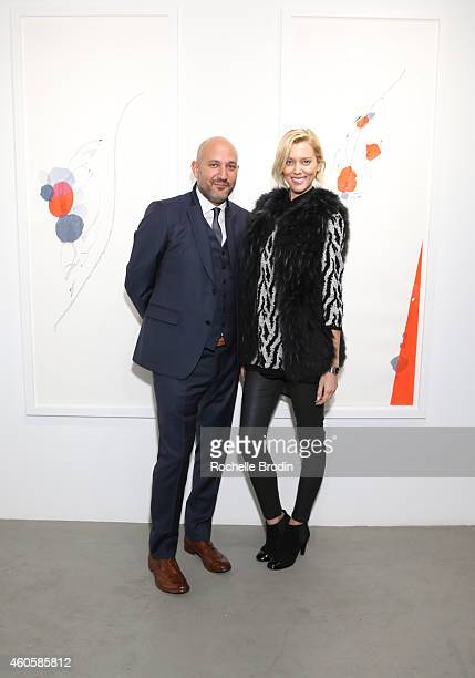 Taylor Reynolds and Steph Sebbag attend the Alison Bignon Fragments exhibition at De Re Gallery on December 16 2014 in West Hollywood California