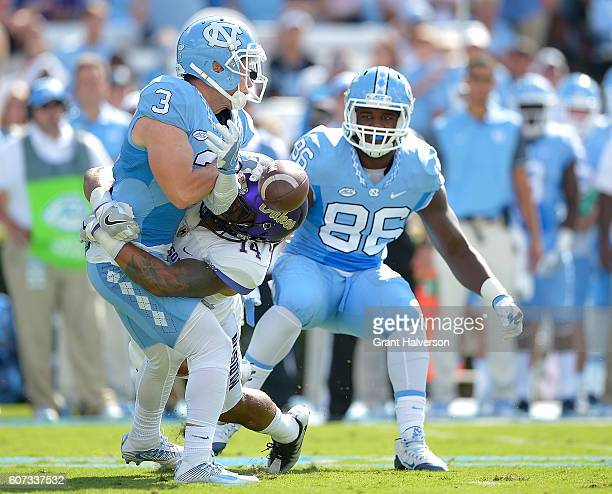 Taylor Reynolds of the James Madison Dukes breaks up a pass intended for Ryan Switzer of the North Carolina Tar Heels during the game at Kenan...