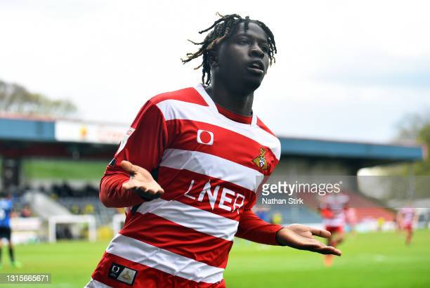 Taylor Richards of Doncaster Rovers celebrates as he scores their second goal during the Sky Bet League One match between Rochdale and Doncaster...
