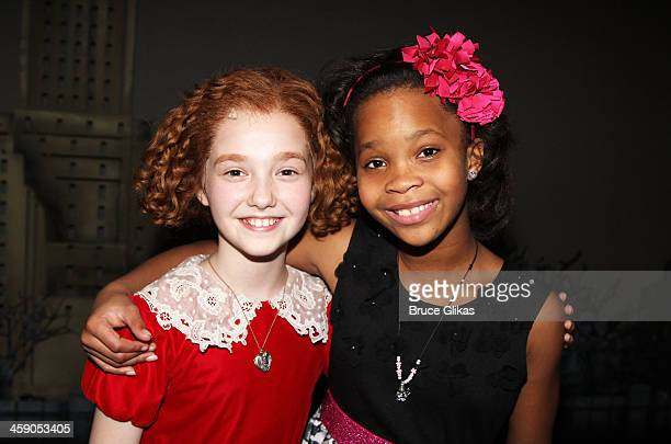 Taylor Richardson as Annie and Quvenzhané Wallis pose backstage at Annie on Broadway at The Palace Theater on December 22 2013 in New York City